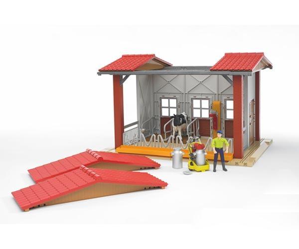 Granja con equipo de ordeño, vacas y granjero - Ítem1