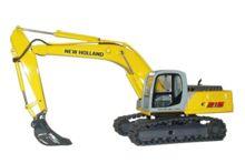 Réplica excavadora NEW HOLLAND E215 cadenas metálicas - Ítem1