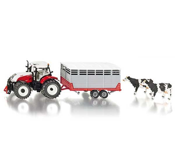 Tractor STEYR con remoque transporte de vacas