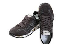 Zapatilla deportiva con cordones, en ante y nylon mimetizado marrón. Logo piel. Piso de goma.