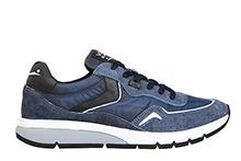 Zapatilla deportiva con cordones, en piel, ante y tejido azul.Piso de goma.