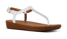 Sandalia de dedo con brillantes en pala. Color blanco. Piso de goma. Altura de 3 cm.