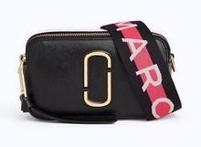 Mini bolso en piel- Tira extraíble en tela estampada logo.