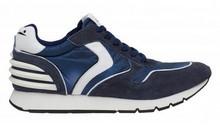 Deportiva en ante, nylon y piel combinada en azul y detalles blancos. Suela de goma.