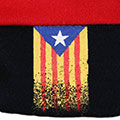 Detall de la barretina tradicional catalana de 5 pams roja amb estelada pintada a mà