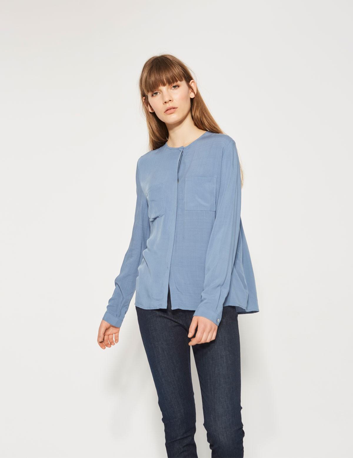 Camisa pinzas en espalda