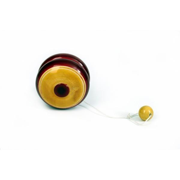 La madera de este yo-yo está lacada con tintes vegetales en una gama de colores única por sus brillos y tonalidades.