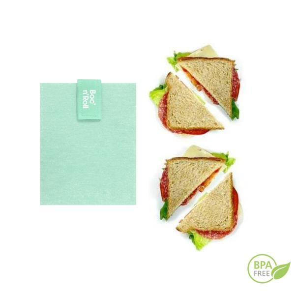 El portabocadillos verde Bloc'n'Roll es un envoltorio reutilizable que te permite envolver y llevar tu bocadillos o piezas de fruta. Su cierre fácil lo ajusta a cualquier alimento.