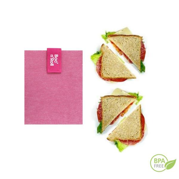 El portabocadillos lila Boc'n'roll es un envoltorio reutilizable que te permite envolver y llevar tu bocadillos o piezas de fruta. Su cierre fácil lo ajusta a cualquier alimento.