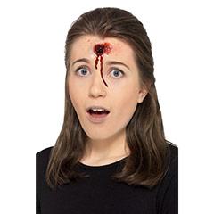 Herida de bala con sange protésico