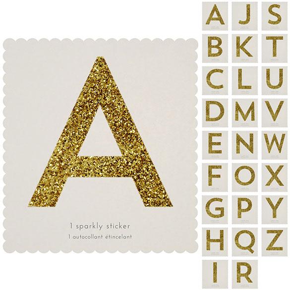 Letra adhesiva dorada con purpurina, de 10 cm de alto.