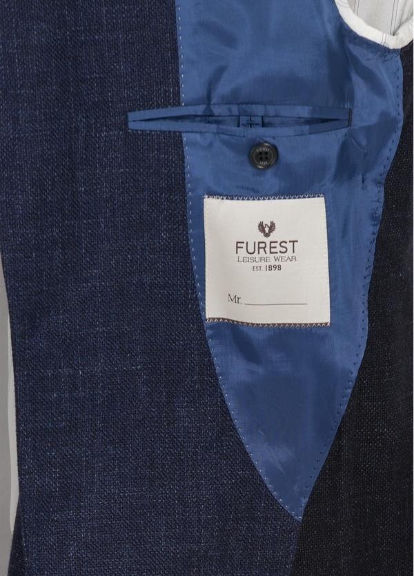 Americana textura ligeramente slim fit color azul, 70% Algodón 30% Lana. - Ítem4