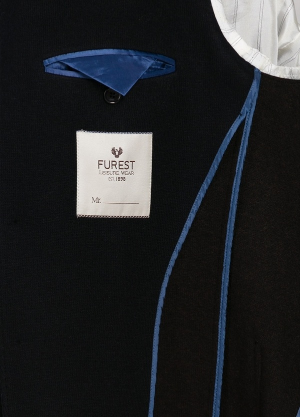 Americana textura ligeramente slim fit color azul marino. 100% Lana. - Ítem1