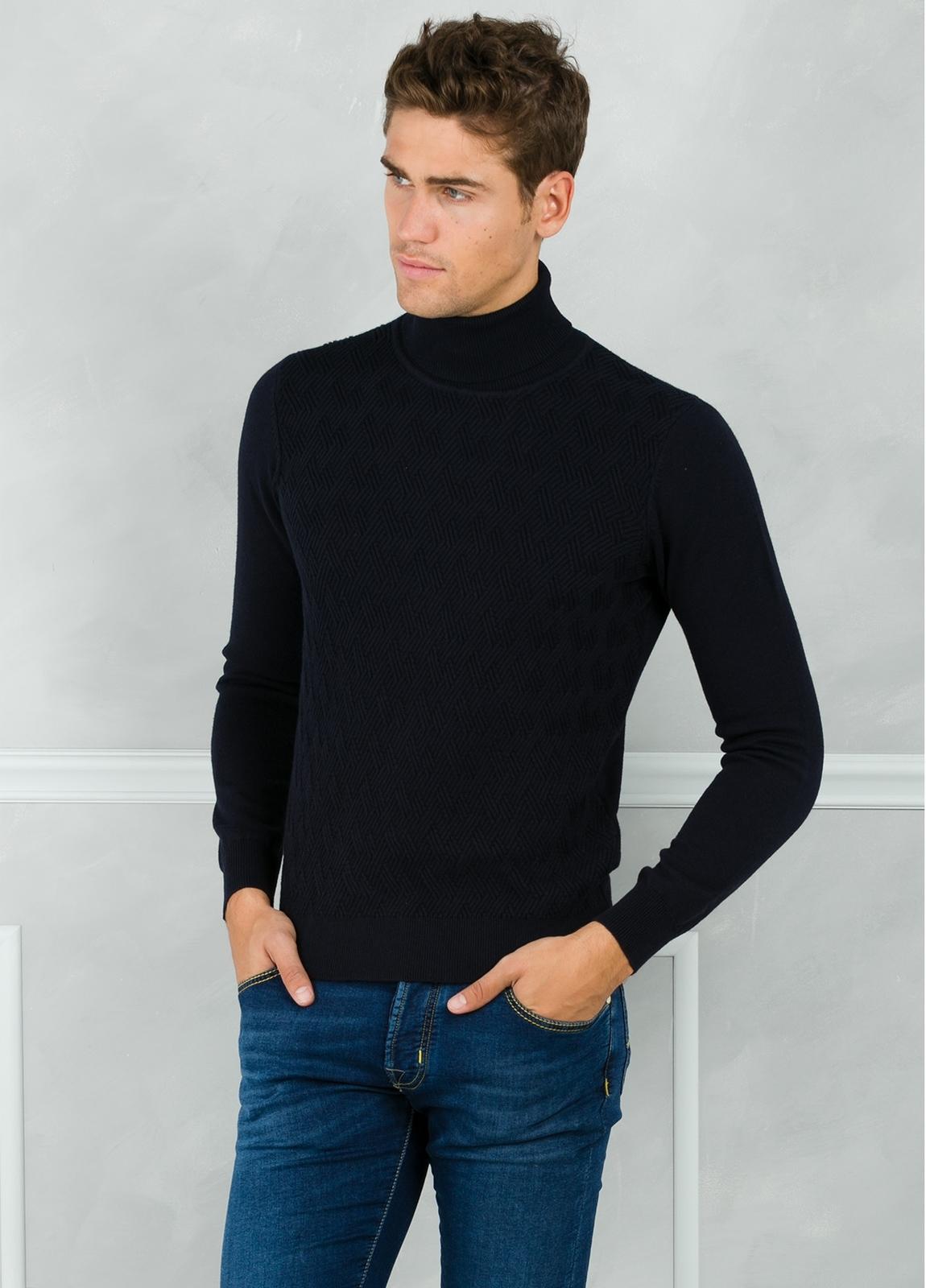 Jersey cuello cisne y dibujo frontal, color azul marino. 90% Algodón 10% Cashmere.