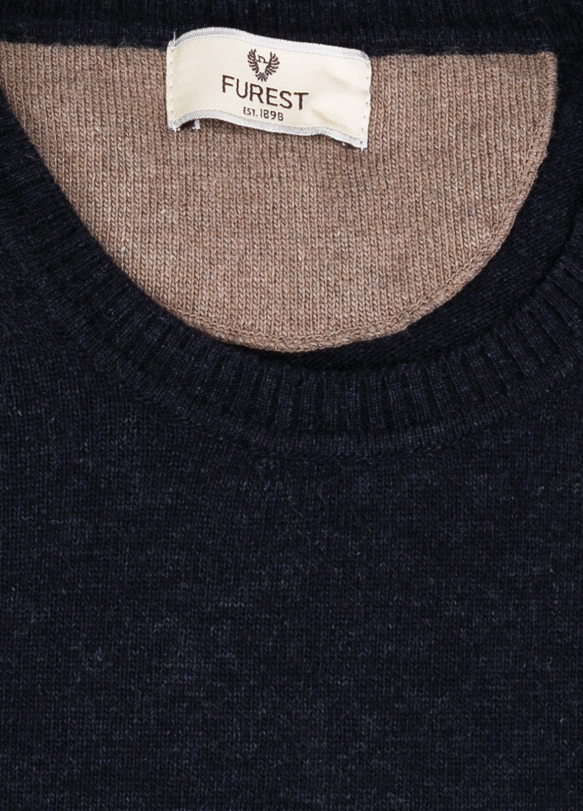 Jersey liso cuello redondo color azul marino, 40% lana merino, 20% viscosa, 10% cachemire