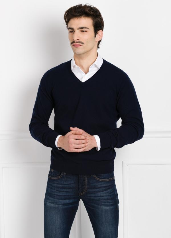 Jersey liso cuello pico color marino, cashmere 100%.