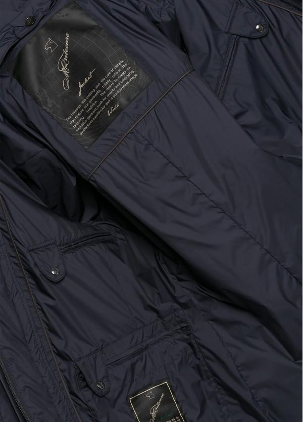 Chaqueta con pecherín interior color azul marino, tejido técnico repelente al agua. - Ítem1