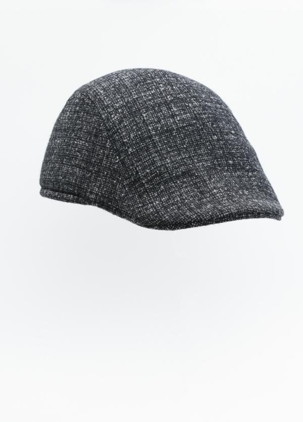Gorra tipo ascot color gris tejido de lana con diseño jaspeado.