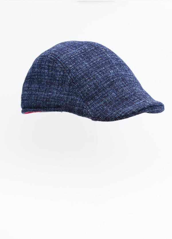 Gorra tipo ascot color azul tejido de lana con diseño jaspeado.