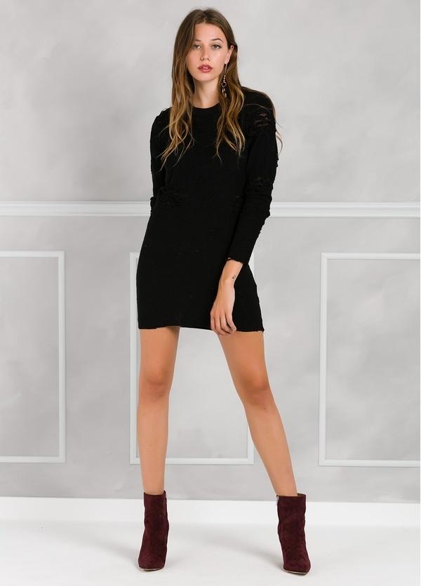 Vestido corto de manga larga color negro con detalles calados.
