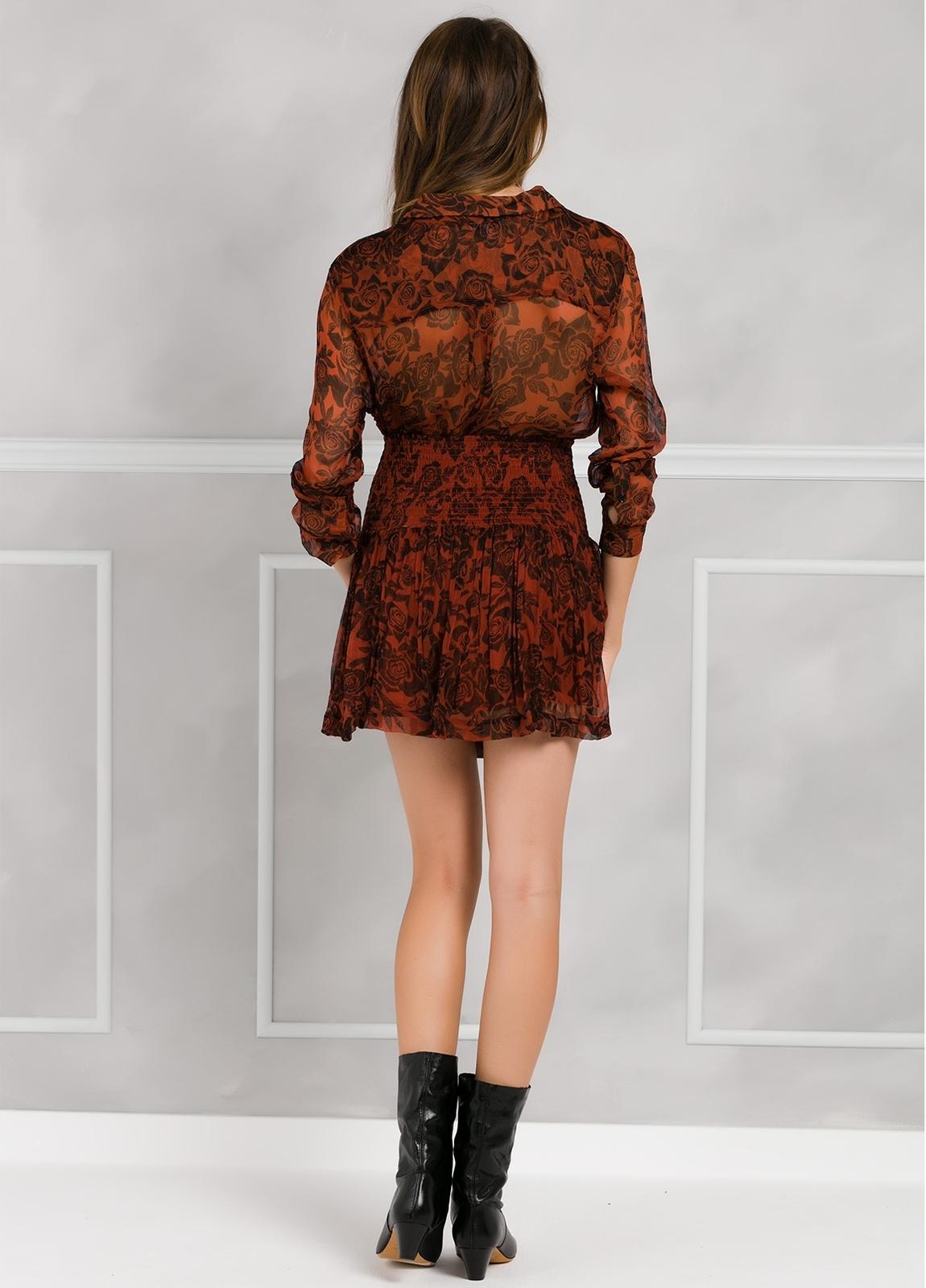 Falda plisada con fruncido en cintura, color teja y estampado floral. - Ítem1