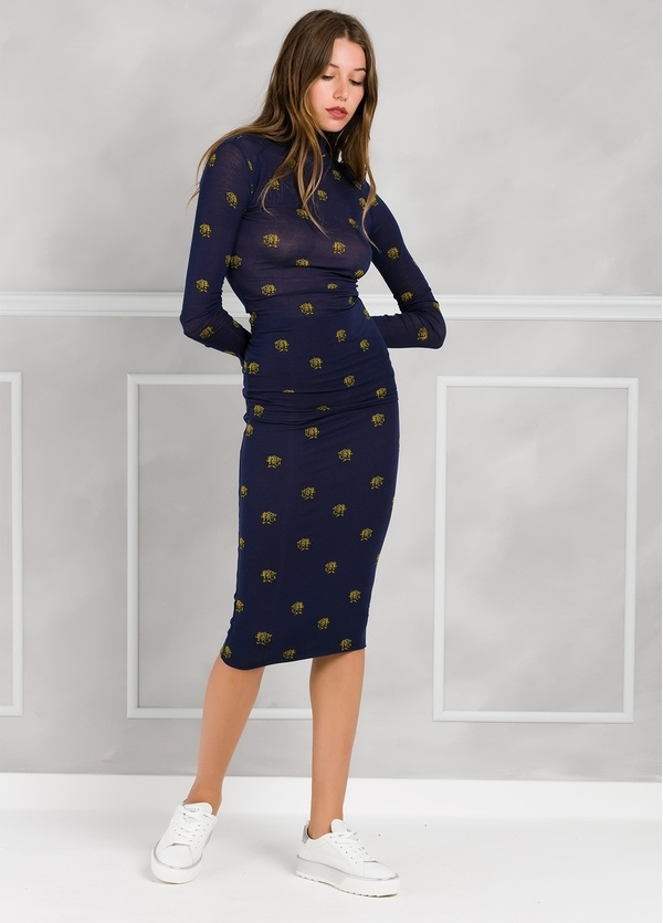 Falda tubo color azul marino con dibujo impreso leopardos. 94% Lyocell 6% Elastane.