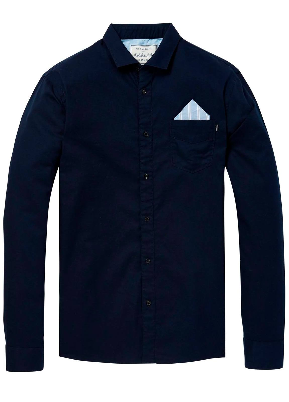 Camisa REGULAR FIT, cuello clasico, bolsillo pecho con pañuelo. Tejido oxford, lisa, color azul marino . 100% Algodón.