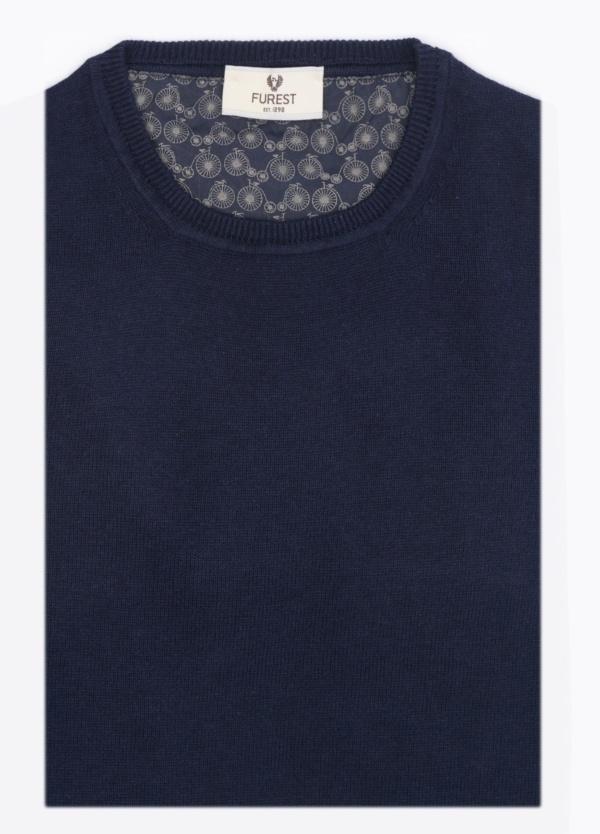 Jersey liso, cuello redondo, color azul marino. 80% Lana, 20% Nylon.
