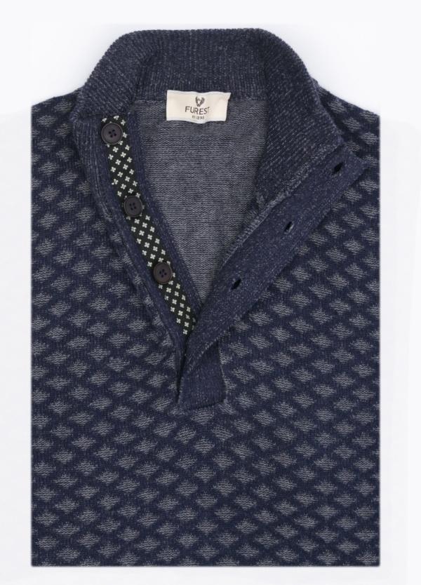 Jersey cuello botones, dibujo fantasía, color azul marino. 90% Algodón, 10% Cashemere.