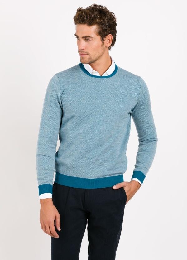 Jersey cuello redondo color celeste,rayas azul turquesa en puños , cuello y cintura, 100 % lana