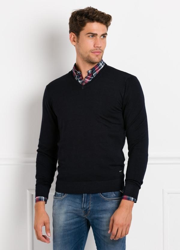 Suéter manga larga, cuello pico, color azul marino. 100% Lana.