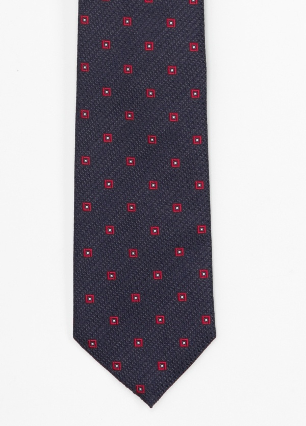 Corbata Formal Wear microtextura color azul, dibujo geométrico. Pala 7,5 cm. 100% Seda.