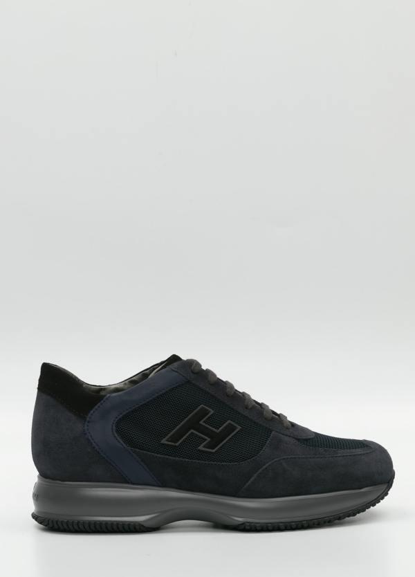 Calzado sport color negro.Combinación de piel, ante y tejido técnico