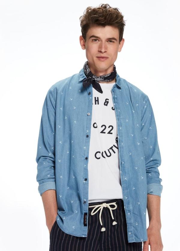 Camisa tejana color azul lavado con estampado palmeras. 100% Algodón.