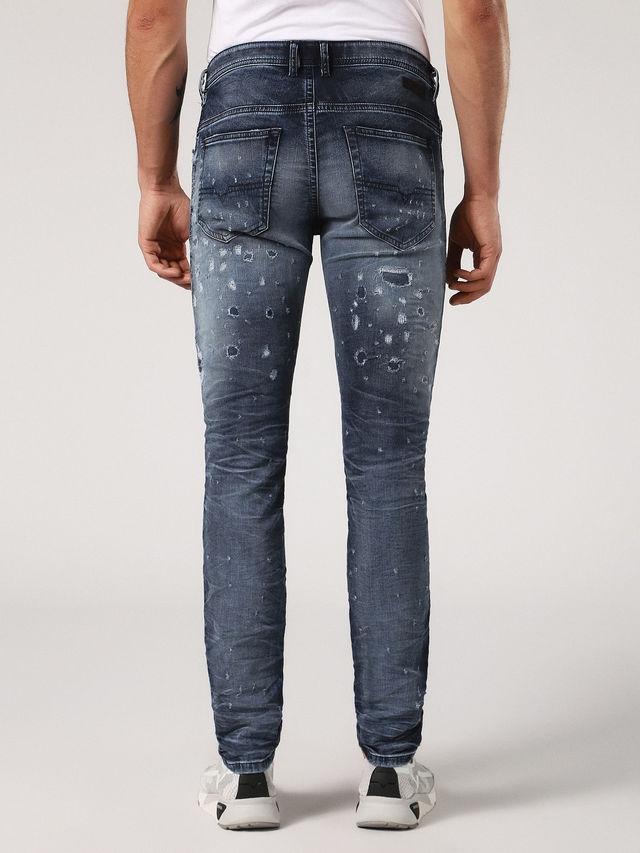 Pantalón tejano skinny modelo THOMMER color azul medio lavado con detalles rasgados. 90% Algodón 8% Poliéster 2% Elastano. - Ítem1