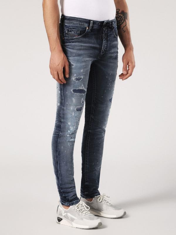 Pantalón tejano skinny modelo THOMMER color azul medio lavado con detalles rasgados. 90% Algodón 8% Poliéster 2% Elastano. - Ítem3
