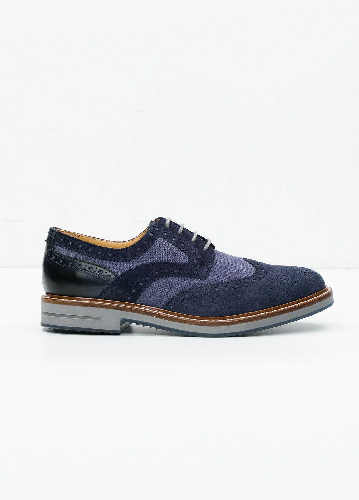 Zapato Sport Wear color azul. Combinación de serraje y piel con troquelado.