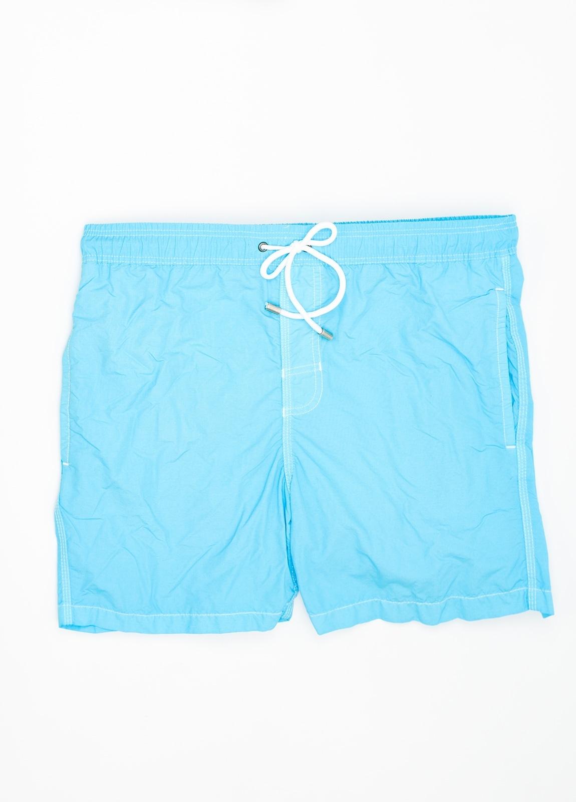 Bañador liso color azul turquesa.