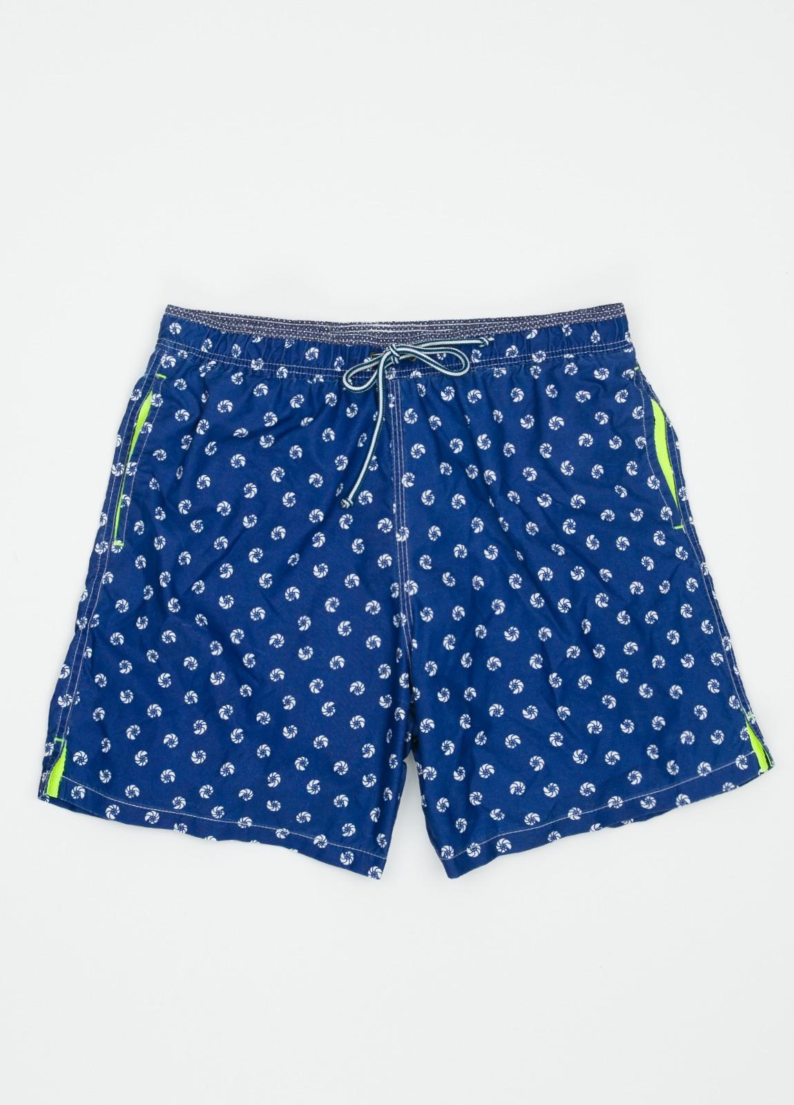 Bañador con estampado de caracolas color azul medio.