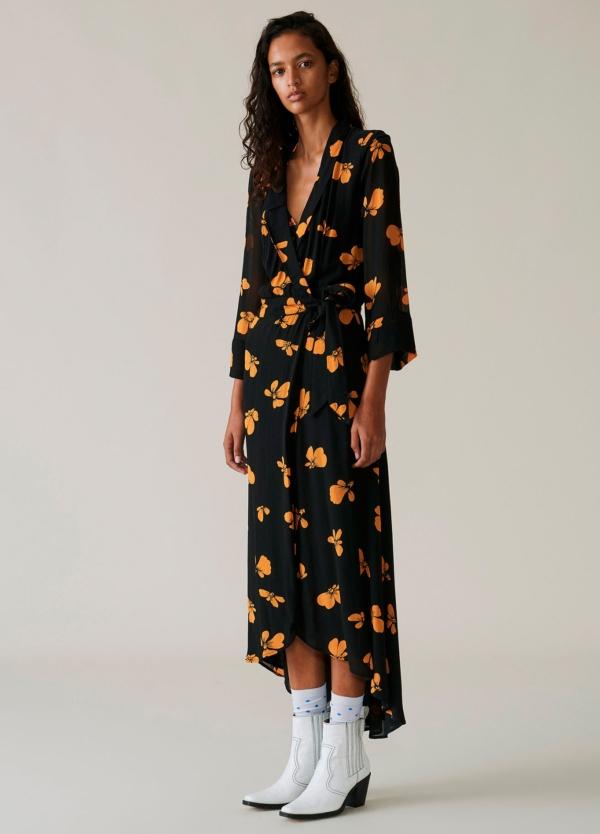 Vestido largo asimétrico color negro con estampado floral. 100% Viscosa.