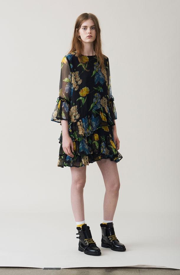 Vestido corto con volantes color negro con estampado floral. 100% Viscosa. - Ítem1
