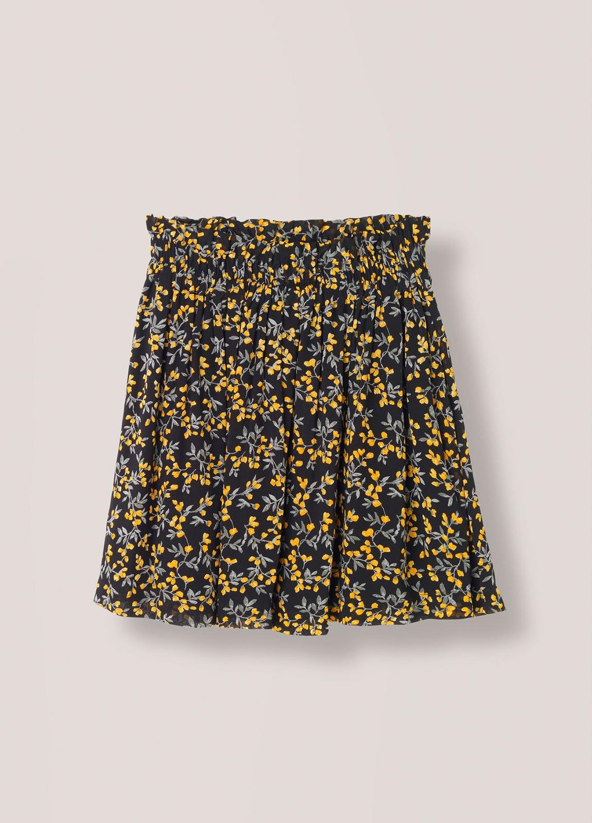 Falda corta plisada con cintura elástica color negro con estampado floral. 100% Viscosa. - Ítem3