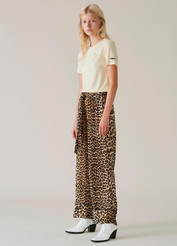 Pantalón ancho con cintura elástica y estampado animal print. 100% Viscosa.
