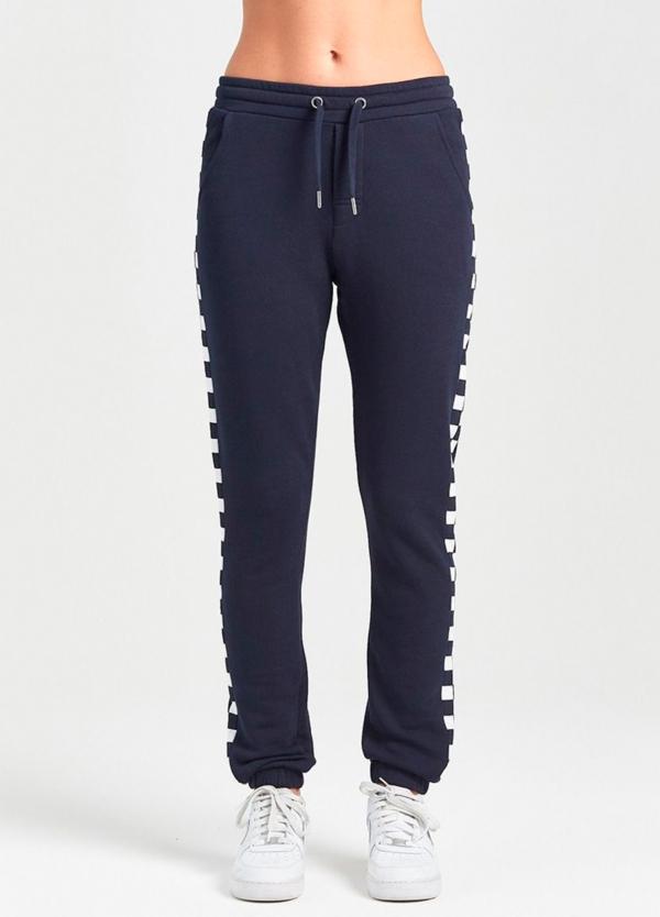 Pantalón jogging relaxed fit color negro con dibujo lateral geométrico. 80% Algodón 20% Poliéster. - Ítem1