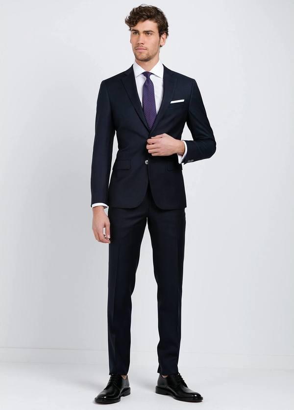 Traje liso SLIM FIT, tejido GUABELLO, color azul marino, 100% Lana fría.
