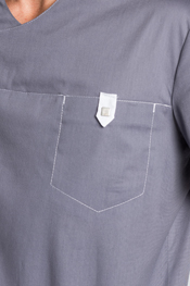 Gray health tunic with snap fastener.