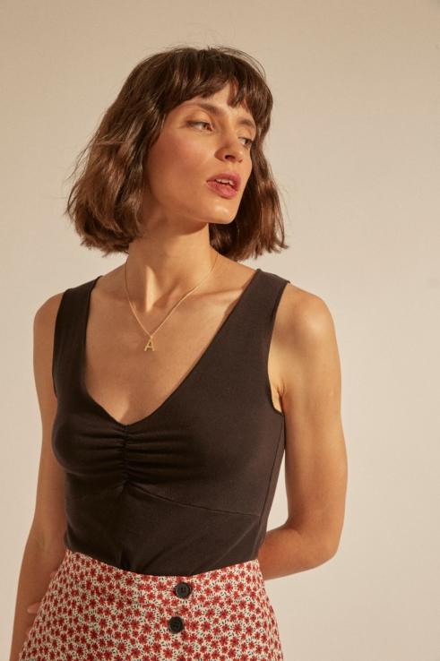 draped neckline black top