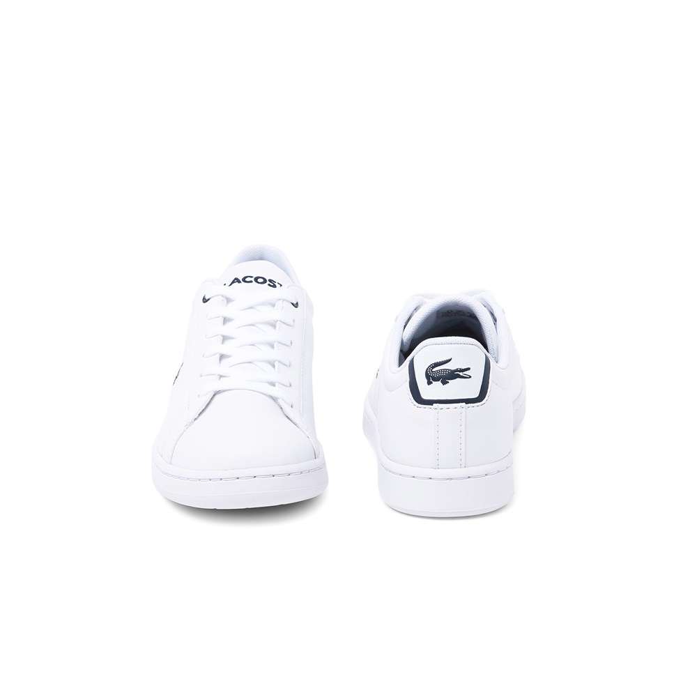 Zapatillas Lacoste modelo Carnaby en color blanco con azul para junior-d