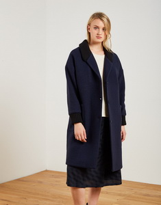 Wool coat with cuffs and ribbed lapel.