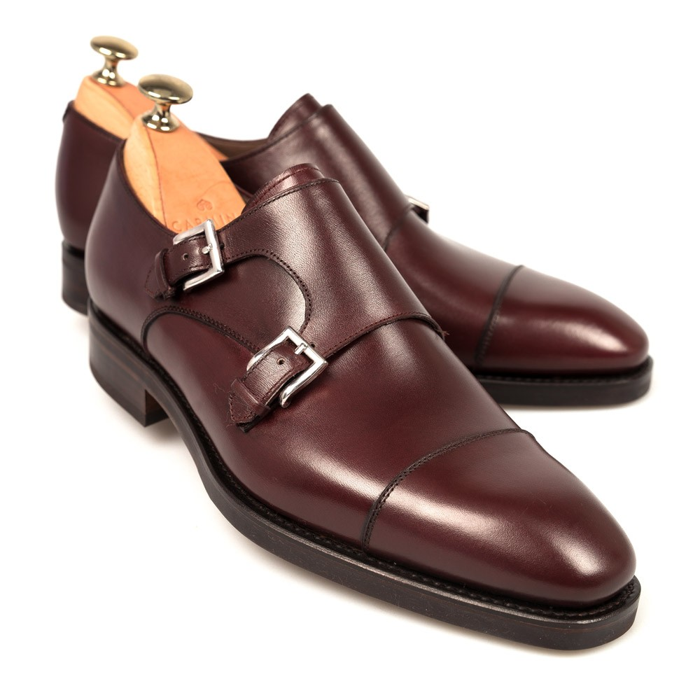 This shoe w As a contemporary yet refined alternative to the classic derby shoe, this double monk strap has been buffed by hand for a truly unique and distinctive aesthetic. The leather sole features a rubber insert, adding practicality to the mix.
